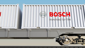 Railway transportation of containers with Robert Bosch GmbH logo. Editorial 3D rendering Stock Photography