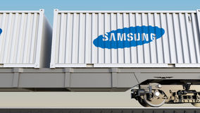 Railway transportation of containers with Samsung logo. Editorial 3D rendering Stock Photography