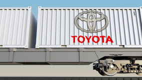 Railway transportation of containers with Toyota logo. Editorial 3D rendering Stock Photography
