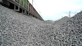 Railway. Transportation of crushed stone by rail. Unloading railway platform. The mountains of crushed granite stock video