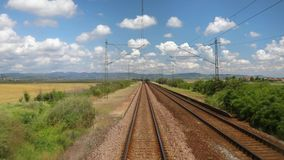 Railway travel view. Train journey point of view, leaving a station stock video footage