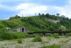 Railway tunnel at mountain Stock Image