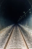 Railway in tunnel through the mountains Royalty Free Stock Image