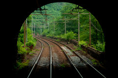 Railway tunnel. Out of a railway tunnel Stock Photos
