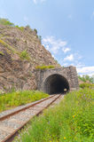 The railway tunnel in a rock on the bank of lake Baikal. Royalty Free Stock Images