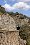 Railway tunnel and wall in mountain. Stock Images