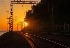 Railway turn at sunset Royalty Free Stock Photo