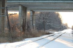 The Railway Under the Bridge. A railway and landline passing under a bridge in winter Royalty Free Stock Photography