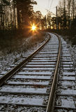 Railway under a thin layer of the first snow Stock Photo