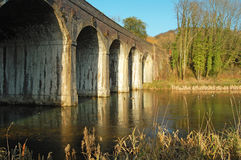 Railway viaduct. Over watercourse in english countryside Stock Image