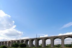 Railway viaduct. And the blue and cloudy sky, Poland Royalty Free Stock Images