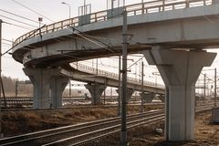 Railway and viaduct industrial area of the city. In the sunset rays stock images