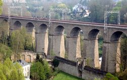 Railway viaduct Pulvermuhle in Luxembourg City. The Old Pulvermuhle Viaduct in Luxembourg City is an ancient arch bridge - a railway bridge - which crosses the Royalty Free Stock Image
