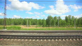 Railway. View to the side railroad out of the window of moving coach stock footage