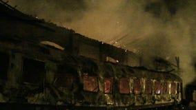 Railway wagon on fire. At night stock video