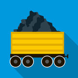 Railway wagon loaded with coal icon, flat style. Railway wagon loaded with coal icon in flat style on a blue background Royalty Free Stock Photo
