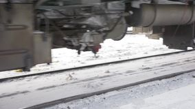 Railway wagon and locomotive truck. Riding the rails in the snowy winter day stock video footage