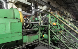 Railway wheels subway train in metal working machine.  royalty free stock images