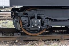 Railway wheels wagon .Freight cargo train. New 6-axled flat wagon ,Type: Sahmmn, Model WW 604 A, Transvagon AD. Railway wheels wagon . Black Freight cargo train Stock Photography