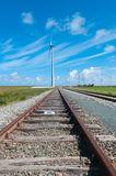 Railway and windmills. View of a railway and windmills Stock Image