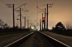 Railway in winter night. Electric railway in winter night Royalty Free Stock Photo