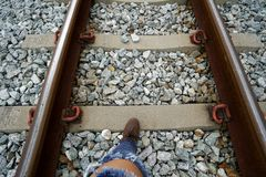 Railway and women leg in boots royalty free stock images