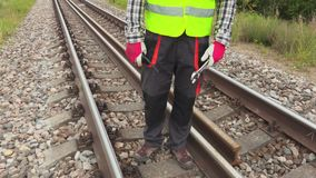 Railway worker on railway track. In summer day stock footage