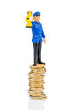 Railway worker stands on money stack. Railway worker on money stack symbol photo for early retirement, costs for rail Stock Photography