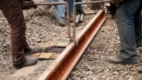 Railway workers bolting track rail stock video