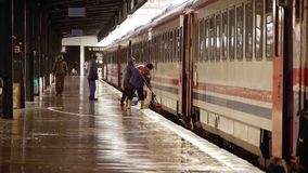 Railway workers on platform - editorial stock video footage