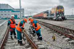 Railway workers repairing rail in rain Stock Images