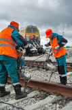 Railway workers repairing rail in Tobolsk. Russia Royalty Free Stock Photos