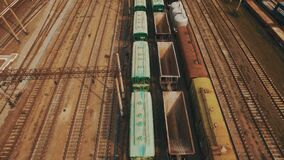 Railway yard with a lot of railway lines and freight trains. Aerial. Railway yard with a lot of railway lines and freight trains, Rail freight marshalling yard stock video