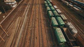 Railway yard with a lot of railway lines and freight trains. Aerial. Railway yard with a lot of railway lines and freight trains, Rail freight marshalling yard stock video footage