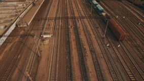 Railway yard with a lot of railway lines and freight trains. Aerial. Railway yard with a lot of railway lines and freight trains, Rail freight marshalling yard stock footage