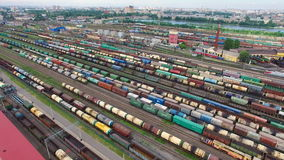 Railway yard with a lot of railway lines and freight trains, Rail freight marshalling yard, Russian Railways. stock video