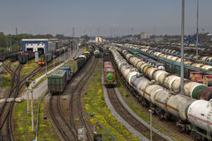 Railway yard with a lot of railway lines and freight trains. Stock Photo
