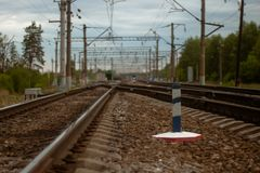 Railways crossing in the blur. Some railways go forward. Trees both sides. Nice blurred background stock photo