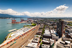 Railways and docks from Harbour Centre, Vancouver. The view from the Harbour Centre shows the docks and the massive cranes needed to load and unload containers Royalty Free Stock Photo
