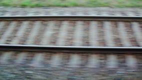 Railways on ground filmed from train. Footage of railways passing by filmed from moving train stock footage