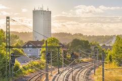 Railways near industrial tower and buildings Stock Photos
