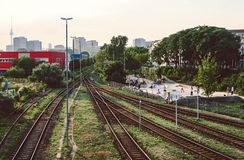 Railways Beside Red Building Stock Photo