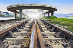Railways track and bridge cross over with urban scene behind use Stock Images