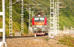 Railways train on background of green mountain slopes Stock Photos