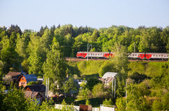 Railways train passes by the holiday village Stock Photo