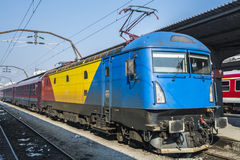 Railways and trains - Gara de Nord Bucharest Romania. Red, Yellow and blue painted locomotive in the North train station in Bucharest Romania Stock Image