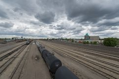 Railyard on cloudy day, Minneapolis, Minnesota. Railyard on cloudy day with tracks converging in the distance near downtown Minneapolis Royalty Free Stock Photography