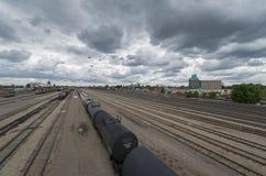 Railyard on cloudy day, Minneapolis, Minnesota. Railyard on cloudy day with tracks converging in the distance near downtown Minneapolis, Minnesota Stock Photo