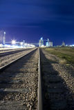 Railyard and grain silos. Railyard and silo at night with room for copy Royalty Free Stock Images