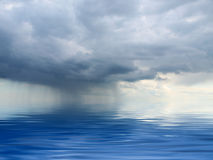 Rain. Clouds hanging over the sea Stock Photo